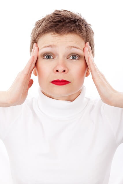 relief for headache lady holding sides of head in pain